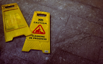 Cleaning in Progress' caution sign